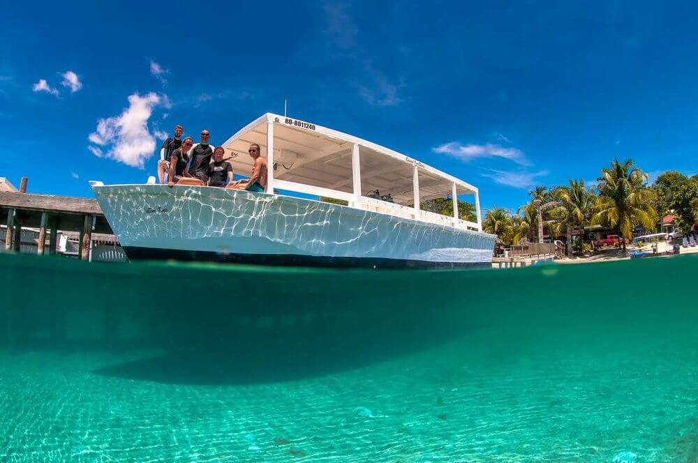 a large scuba diving boat in roatan