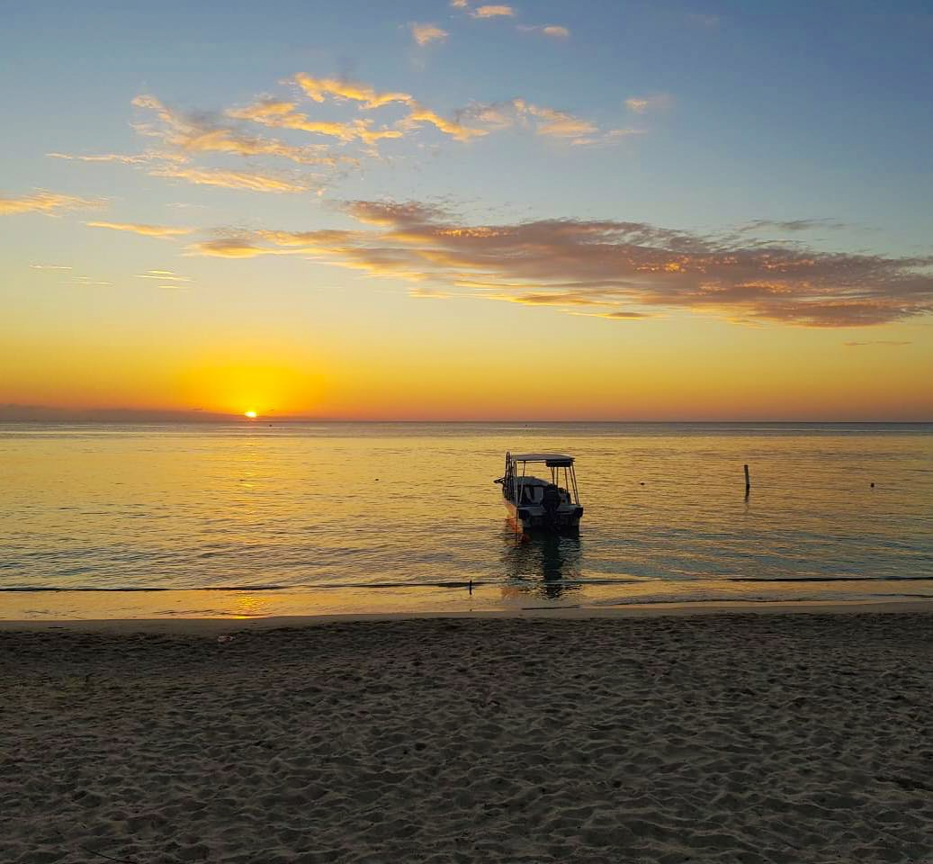 sunset in roatan west bay beach