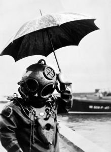 Picture dated 1949 of scuba diver with an umbrella. In 1943, Captain Jacques-Yves Cousteau invents, with Emile Gagnan, the first commercially successful open circuit type of Scuba diving equipment, the aqualung.